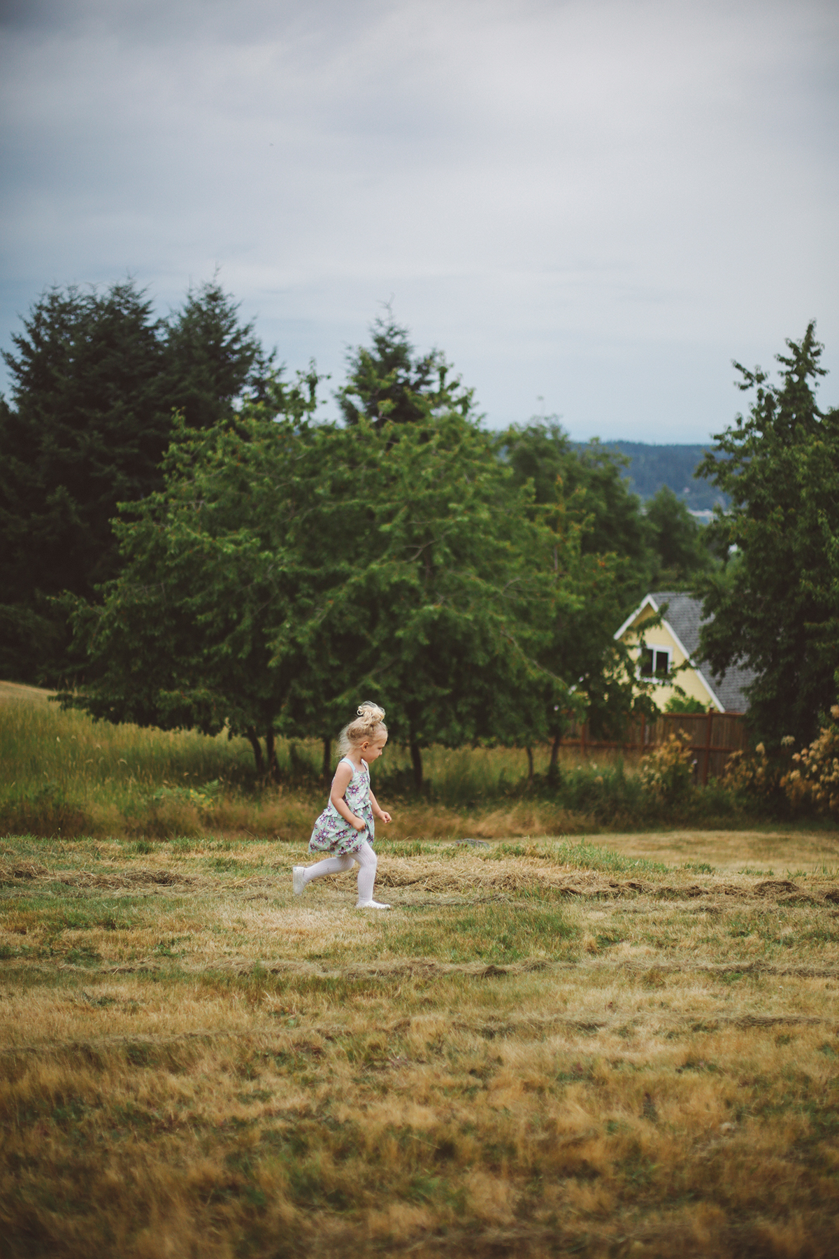 Child running across a lawn