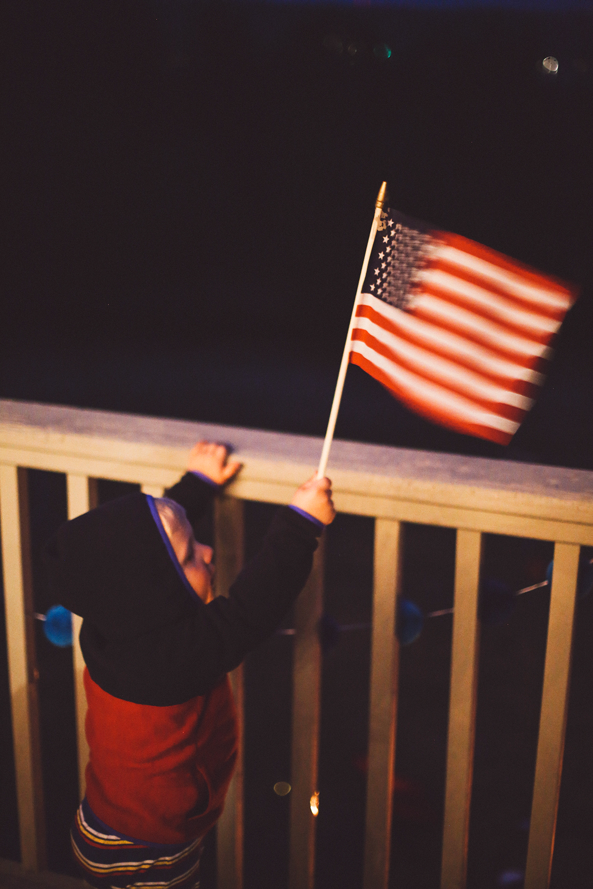 Baby holding the American Flag on the Fourth of July