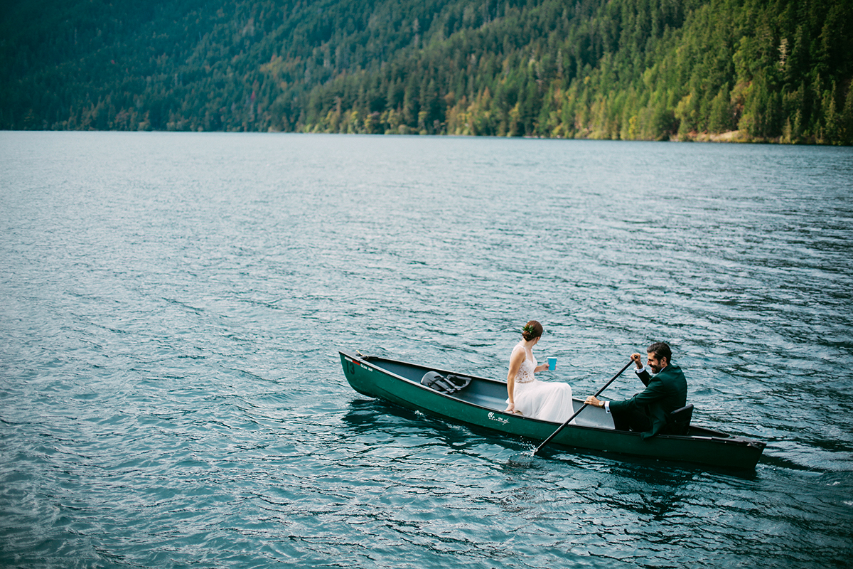 Bride and groom in canoe