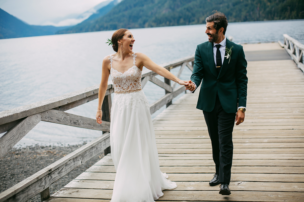 Bride and groom on the dock