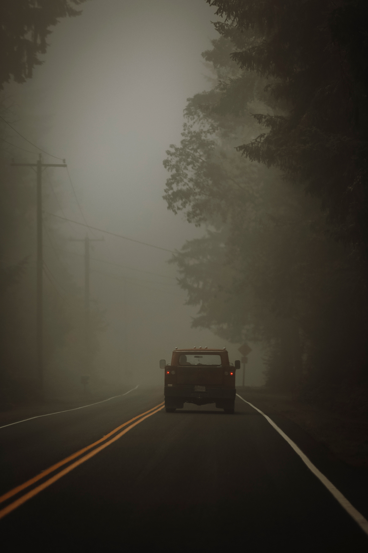 Old truck driving through the fog on Vashon Island