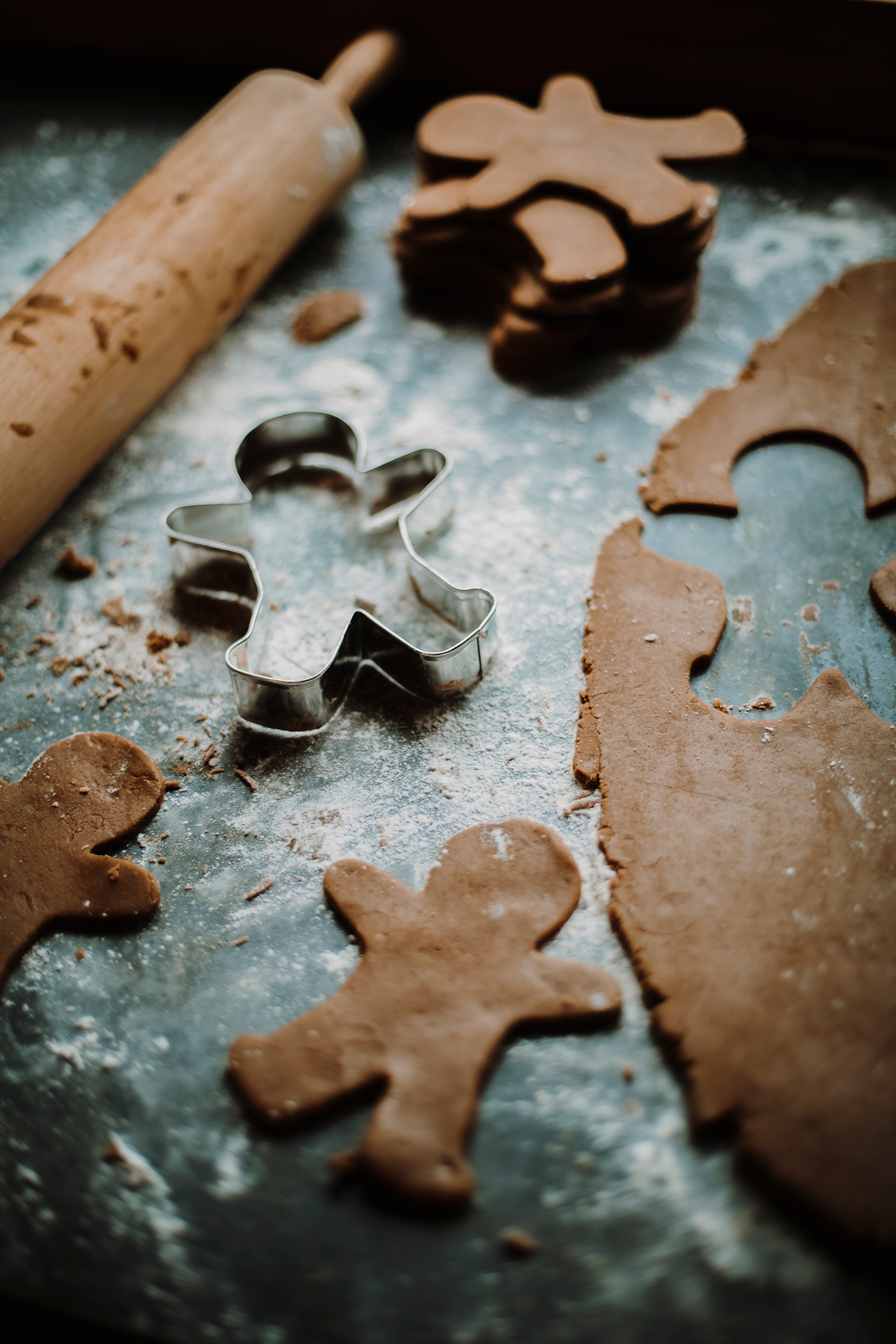 Gingerbread men being cut out of dough